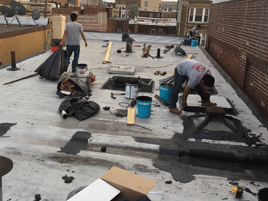 Flat rRoofing Repairs Services On building